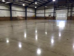 Epoxy removal to polished concrete