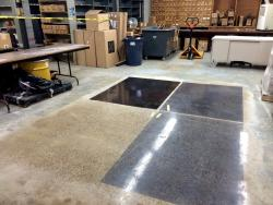 Polished concrete with different levels of black dye